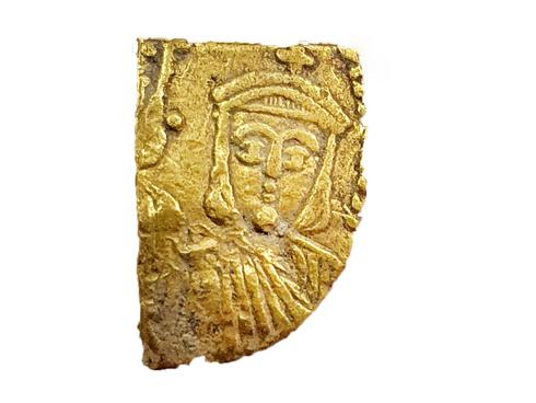 Rare Byzantine coin fragment of the emperor Theophilus (Photo Robert Cole, Israel Antiquities Authority)