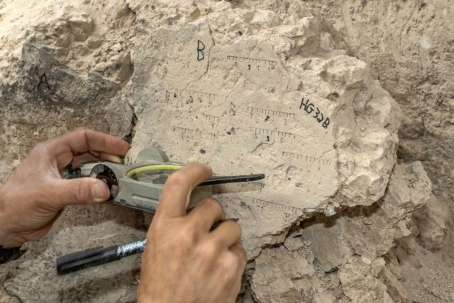 Measurements of the Floor that collapsed during the Destruction. Photographer Shai Halevi Israel Antiquities Authority